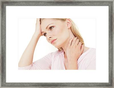 Woman With Hand On Neck Framed Print