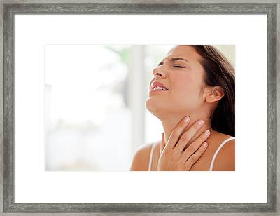 Woman With Hand On Throat In Pain Framed Print