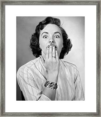 Woman With Hand Over Her Mouth Framed Print by Underwood Archives