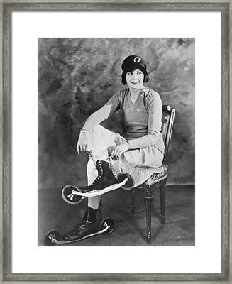 Woman With Her Bicycle Skates Framed Print by Underwood Archives