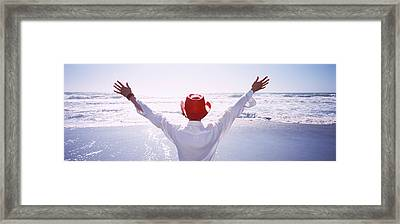 Woman With Outstretched Arms On Beach Framed Print by Panoramic Images