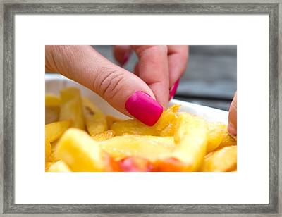 Woman With Pink Nails Eating Chips Framed Print