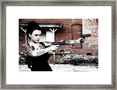 Woman With Pistols Framed Print by Rob Byron