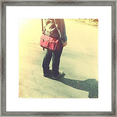 Woman With Red Bag On The Street Framed Print