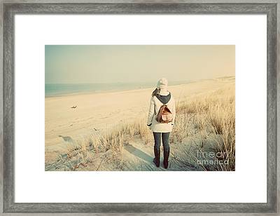 Woman With Retro Backpack On The Beach Looking At The Sea Framed Print
