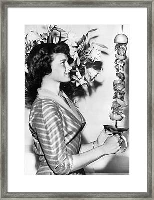 Woman With Shish-kebab Skewer Framed Print by Underwood Archives
