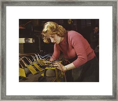 Woman Working On Black-out Lamps Framed Print by Stocktrek Images