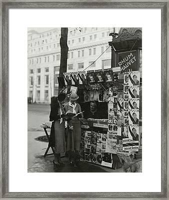 Women At A Newsstand In Paris Framed Print