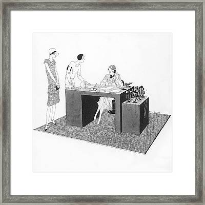 Women At An Office Desk Framed Print