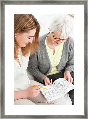Women Doing Puzzle Framed Print by Lea Paterson