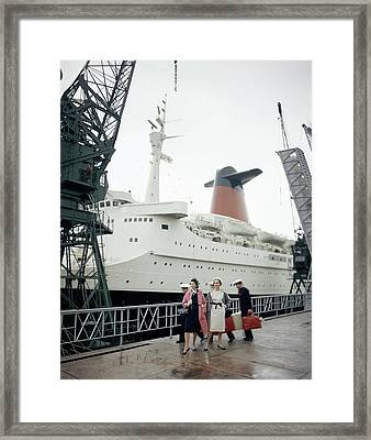 Women In Front Of The S.s. France Framed Print