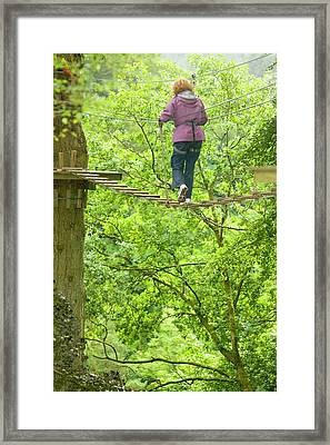Women On Aerial Walkway Framed Print by Ashley Cooper