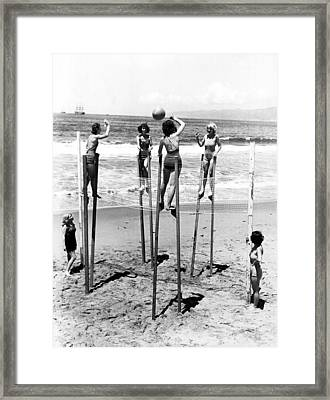 Women On Stilts Framed Print
