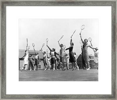 Women Practicing Tennis Framed Print by Underwood Archives
