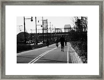 women running and men cycling exercising on bikeway next to West Side Highway new york Framed Print