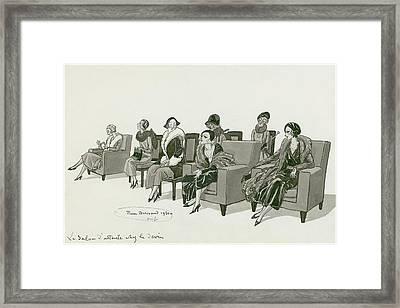 Women Sitting In A Waiting Room Framed Print