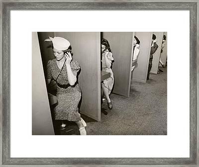 Women Taking Hearing Tests Framed Print