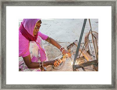 Women Welding Joints Framed Print by Ashley Cooper
