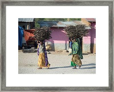 Women With Fire Wood Bundles Framed Print