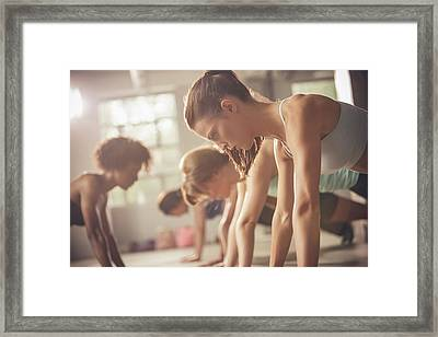 Women Working Out In Exercise Class Framed Print by John Fedele