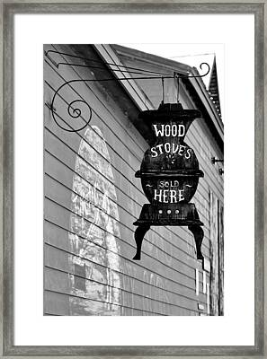 Wood Stoves Sold Here Framed Print by Christine Till