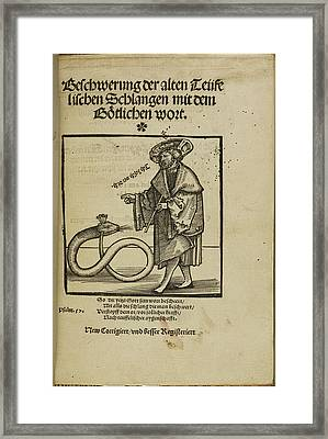 Woodcut Of A Man Addressing A Snake Framed Print by British Library