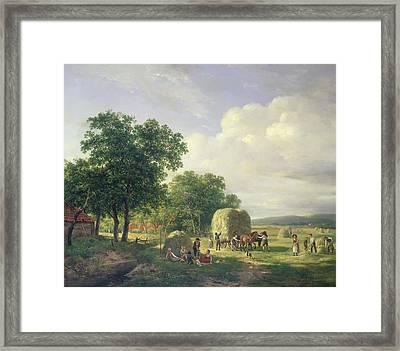 Wooded Landscape With Haymakers Framed Print by Hendrick van de Sande Bakhuyzen
