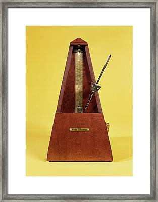 Wooden And Brass Metronome Framed Print