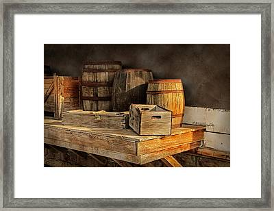 Wooden Barrels And Crates On A Shelf At A Railroad Station Framed Print by Randall Nyhof