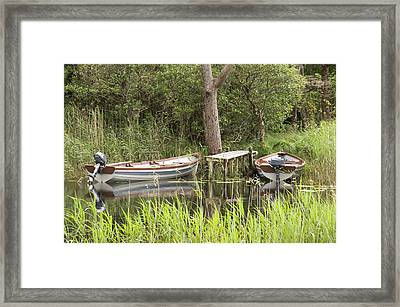 Wooden Boats Framed Print by Jeremy Voisey