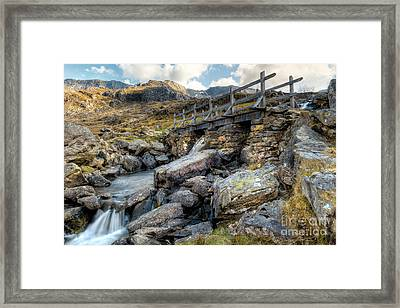 Wooden Bridge Framed Print by Adrian Evans