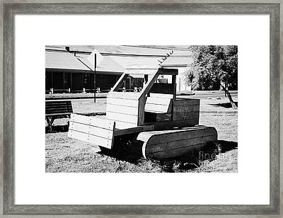 wooden bulldozer in a childrens play area with grafitti star of david scraped onto the side Punta Arenas Chile Framed Print by Joe Fox