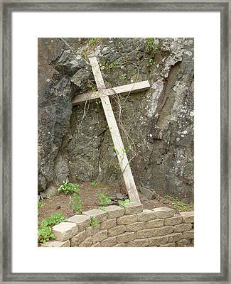 Wooden Cross In The Rocks Framed Print by Jennifer Cairns