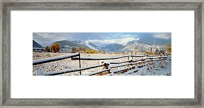 Wooden Fence Covered With Snow Framed Print