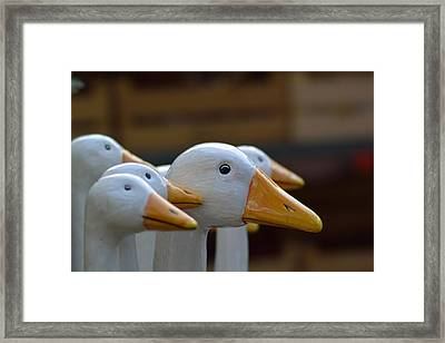 Wooden Geese Framed Print