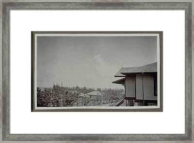 Wooden House On Stilts And The Vegetation And Buildings Make Framed Print