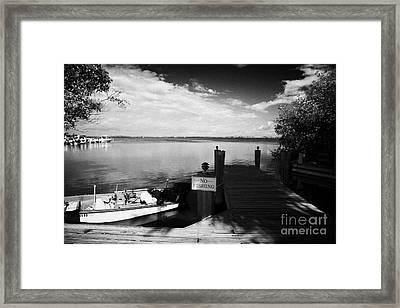 Wooden Jetty And Small Boat Islamorada Florida Keys Usa Framed Print by Joe Fox