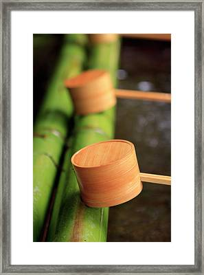 Wooden Ladles Are Placed Framed Print by Paul Dymond