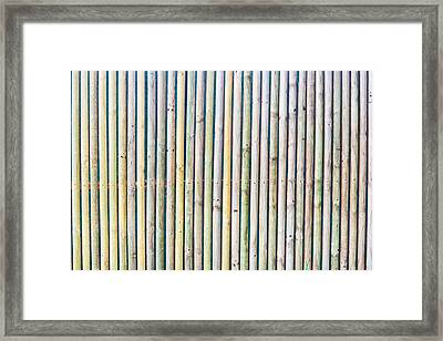 Wooden Poles Framed Print