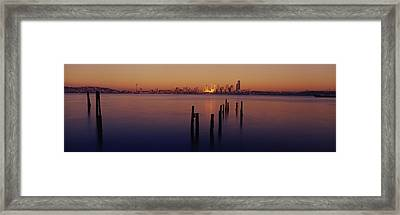 Wooden Posts In The Sea At Dusk Framed Print