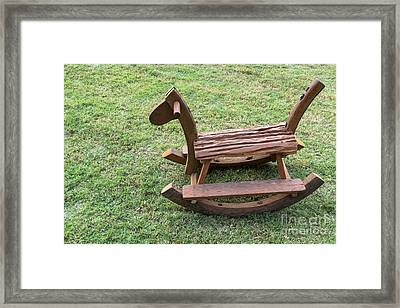 Framed Print featuring the photograph Wooden Rocking Horse by Tosporn Preede