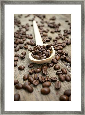 Wooden Spoon With Coffee Beans Framed Print by Aged Pixel