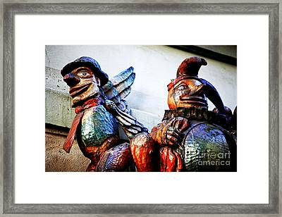 Wooden Statues Framed Print by John Rizzuto