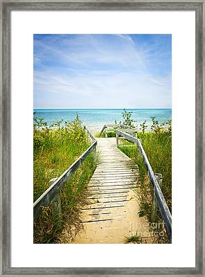 Wooden Walkway Over Dunes At Beach Framed Print