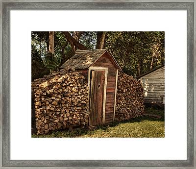 Woodpile And Shed Framed Print