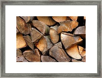 Woodpiles Framed Print