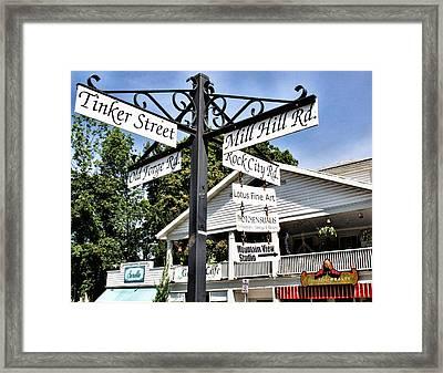 Woodstock Crossroads Framed Print by Nancy  de Flon