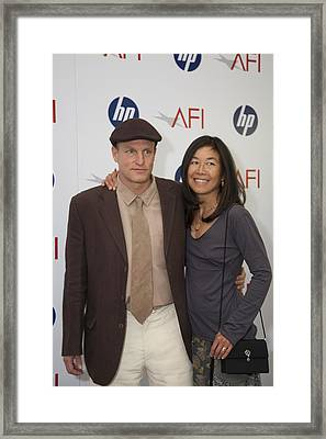 Woody Harrelson And Wife Framed Print by Hugh Smith