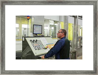 Worker At Car Assembly Line Control Panel Framed Print by Jim West
