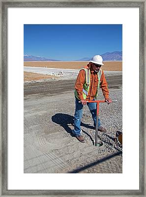 Worker Digging A Bore Hole Framed Print by Jim West